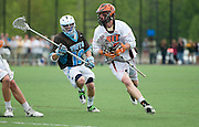 2011/05/22 - RIT's Kelso Davis (right) drives to the goal in the third quarter of the NCAA Division-3 Semifinal. Tufts University defeated RIT 16-12 to advance to the National Championship against Salisbury.
