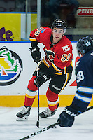 PENTICTON, CANADA - SEPTEMBER 16: Dillon Dube #59 of Calgary Flames skates with the puck against the Winnipeg Jets on September 16, 2016 at the South Okanagan Event Centre in Penticton, British Columbia, Canada.  (Photo by Marissa Baecker/Shoot the Breeze)  *** Local Caption *** Dillon Dube;
