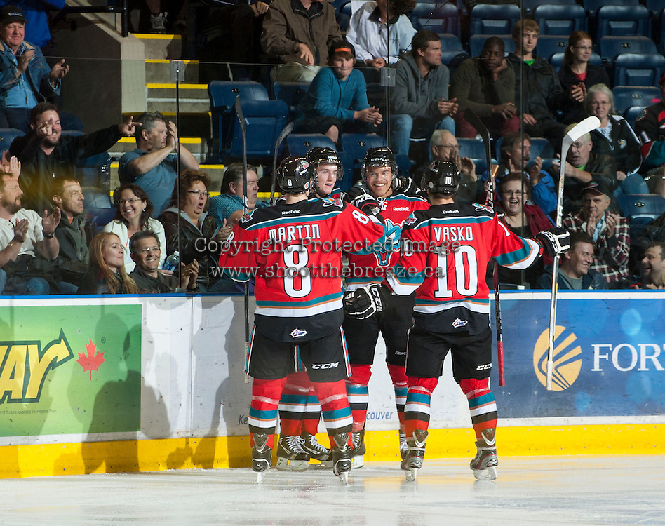 KELOWNA, CANADA - OCTOBER 3: Madison Bowey #4, Colton Sissons #15, Filip Vasko #10 and Cole Martin #8 of the Kelowna Rockets celebrate a goal against the Vancouver Giants at the Kelowna Rockets on October 3, 2012 at Prospera Place in Kelowna, British Columbia, Canada (Photo by Marissa Baecker/Getty Images) *** Local Caption *** Madison Bowey; Coltson Sissons; Cole Martin; Filip Vasko;