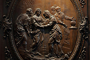 Scene from the Life of the Virgin, detail, bas-relief in a medallion on the sculpted wooden choir stalls, of which 78 of 114 remain, 52 upper and 26 lower stalls, carved by Jean Noel and Louis Marteau after drawings by Rene Charpentier and Jean Dugoulon, early 18th century, in the choir of the Cathedrale Notre-Dame de Paris, or Notre-Dame cathedral, built 1163-1345 in French Gothic style, on the Ile de la Cite in the 4th arrondissement of Paris, France. The high backs of the stalls are decorated with bas-reliefs and separated by trumeaux decorated with foliage and instruments of the Passion. Photographed on 17th December 2018 by Manuel Cohen