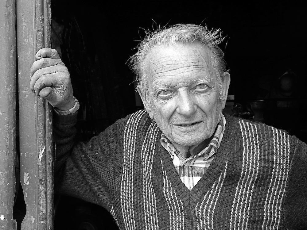 Portrait of old artisan in Menton
