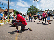 "12 JUNE 2020 - MINNEAPOLIS, MINNESOTA: A man wearing a Colin Kaepernick jersey at the impromptu memorial for George Floyd at the corner of 38th Street and Chicago Ave. in Minneapolis. The intersection is informally known as ""George Floyd Square"" and is considered a ""police free zone."" There are memorials to honor Black people killed by police and people providing free food at the intersection. Floyd, an unarmed Black man, was killed by Minneapolis police on May 25 when an officer kneeled on his neck for 8 minutes and 46 seconds. Floyd's death sparked weeks of ongoing protests and uprisings against police violence around the world.          PHOTO BY JACK KURTZ"