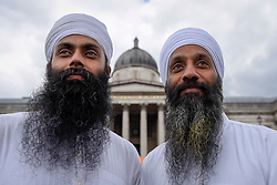 © Licensed to London News Pictures. 29/04/2017. London, UK. Performers ( L to R) Nandh Singh and Harminder Singh of Gurmat Sangeet Academy form part of the entertainment at the Sikh festival of Vaisakhi taking place in Trafalgar Square and hosted by the Mayor of London.  The festival celebrates the beginning of Sikhism, a collective faith which is practiced by more than 20 million people worldwide.   Photo credit : Stephen Chung/LNP