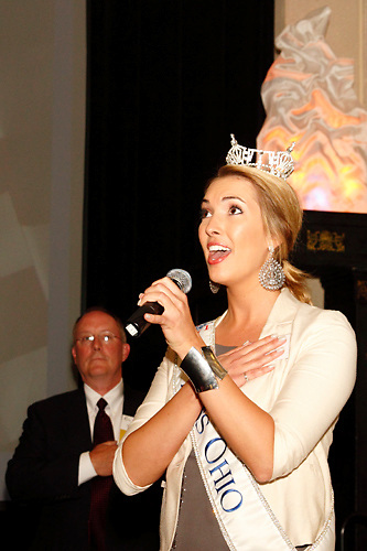 Jeff Siebenthaler of The Siebenthaler Company (left) watches as Miss Ohio 2011 Ellen Bryan sings the National Anthem during the Better Business Bureau's Eclipse Integrity Awards dinner at the Ponitz Center at Sinclair Community College in downtown Dayton, Tuesday, May 8, 2012.