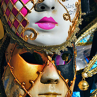 Male and Female Venetian Theater Masks in Venice, Italy <br /> The first Venetian theater masks were worn in 1268 as part of an annual celebration that recognized a military victory in 1162.  They grew in popularity in the Medieval times when prominent people disguised their identity during carnivals while engaged in promiscuous, immoral and carnal activities.  This usage was parodied in comedies about adultery and love by traveling theater companies known as Commedia Dell'arte in the 16th through 18th centuries.