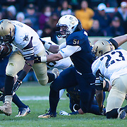Army running back Raymond Maples #1 rush for 11 yards to the NAVY 46 and 1ST DOWN as Navy Linebacker Matt Warrick #51 attempts to make the tackle in the second quarter of the 112th version Of this storied rivalry Saturday, Dec. 10, 2011 at Fed EX field in Landover Md. ..Navy set the tone early in the game as Navy defeats Army 31-17 in front of 82,000 at Fed EX Field in Landover Md