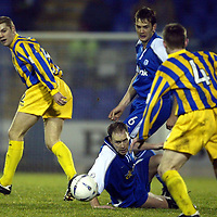 St Johnstone v Queen of the South..  14.12.02<br />Mark Reilly and Ian Maxwell battle Robbie Neilson and Brian McColligan<br /><br />Pic by Graeme Hart<br />Copyright Perthshire Picture Agency<br />Tel: 01738 623350 / 07990 594431