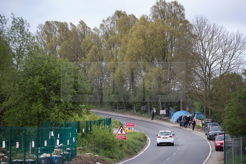 © Licensed to London News Pictures. 28/04/2019. London, UK. Extinction Rebellion have joined with Stop HS2 protestors at their roadside camp to occupy trees in Colne Valley west of London to stop their felling for the HS2 rail project. Workers were expected to start cutting down the trees yesterday and to continue today but the protests have stopped the work. Photo credit: Peter Macdiarmid/LNP