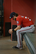 PHOENIX, AZ - JULY 22:  Bryce Harper #34 of the Washington Nationals sits in the dugout during the MLB game against the Arizona Diamondbacks at Chase Field on July 22, 2017 in Phoenix, Arizona.  (Photo by Jennifer Stewart/Getty Images)