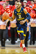 LUBBOCK, TX - JANUARY 13: Jevon Carter #2 of the West Virginia Mountaineers brings the ball up court during the game against the Texas Tech Red Raiders on January 13, 2018 at United Supermarket Arena in Lubbock, Texas. Texas Tech defeated West Virginia 72-71. (Photo by John Weast/Getty Images) *** Local Caption *** Jevon Carter