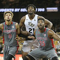 ORLANDO, FL - NOVEMBER 15: Jamaal Robateau #0 and DJ Laster #25 of the Gardner Webb Runnin Bulldogs block out Chad Brown #21 of the UCF Knights during a NCAA basketball game at the CFE Arena on November 15, 2017 in Orlando, Florida. (Photo by Alex Menendez/Getty Images) *** Local Caption *** Jamaal Robateau; DJ Laster; Chad Brown