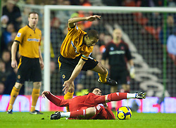 LIVERPOOL, ENGLAND - Saturday, December 26, 2009: Liverpool's Alberto Aquilani and Wolverhampton Wanderers' Karl Henry during the Premiership match at Anfield. (Photo by: David Rawcliffe/Propaganda)