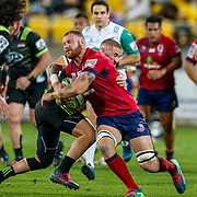 Scott Higginbotham (captain) tackled by TJ Perenara (captain) during the Super rugby union game (Round 14) played between Hurricanes v Reds, on 18 May 2018, at Westpac Stadium, Wellington, New  Zealand.    Hurricanes won 38-34.
