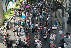 © Licensed to London News Pictures. 24/05/2014. Anti-Coup protestors hold up banners showing their displeasure while marching towards the Military Junta following a Anti-Coup protest in Bangkok Thailand. The Royal Thai army announced a Military coup and have imposed a 10pm curfew.  Photo credit : Asanka Brendon Ratnayake/LNP