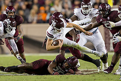 Mississippi State quarterback Nick Fitzgerald (7) is tackled by Texas A&M linebacker Tyrel Dodson (25) during the second quarter of an NCAA college football game on Saturday, Oct. 28, 2017, in College Station, Texas. (AP Photo/Sam Craft)