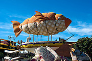 "Trader Joe's, ""Look Ma no Hands"" Orange, colored Flowers, fish, Ballooon Sail, over Sailboat, Rose Parade;  Pasadena;, CA, Tournament of Roses, LA California; Los Angeles High dynamic range imaging (HDRI or HDR)"