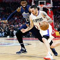 23 December 2016: LA Clippers guard J.J. Redick (4) drives past Dallas Mavericks guard Wesley Matthews (23) during the Dallas Mavericks 90-88 victory over the LA Clippers, at the Staples Center, Los Angeles, California, USA.