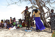Women meet under a tree at the Kakimat outreach site. These clinics provide immunisations and nutrition support and advice...The women walk for miles to visit these clinics.