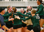 "The West High varsity volleyball team celebrates their win at a high school volleyball game against Iowa City High School at Iowa City West High School in Iowa City on Tuesday, Sept. 6, 2016. Iowa City West won the ""Battle of the Spike"" 25-19, 22-25, 25-22, and 25-21. (Rebecca F. Miller/The Gazette)"