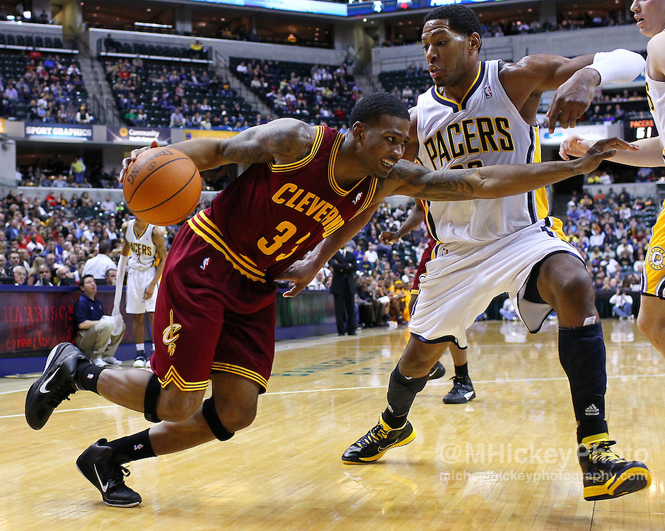 Dec. 30, 2011; Indianapolis, IN, USA; Cleveland Cavaliers shooting guard Alonzo Gee (33) drives to the basket as Indiana Pacers small forward Danny Granger (33) defends at Bankers Life Fieldshouse. Indiana defeated Cleveland 81-91. Mandatory credit: Michael Hickey-US PRESSWIRE