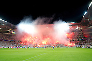 Legia's supporters with fireworks during the UEFA Champions League play-off second leg match between Legia Warsaw and FC Steaua Bucuresti at Pepsi Arena Stadium in Warsaw on August 27, 2013.<br /> <br /> Poland, Warsaw, August 27, 2013<br /> <br /> Picture also available in RAW (NEF) or TIFF format on special request.<br /> <br /> For editorial use only. Any commercial or promotional use requires permission.<br /> <br /> Photo by &copy; Adam Nurkiewicz / Mediasport