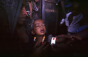 Malnourishe and sick baby at a supplementary food screening. With the failure of the rains families are facing another year of severe food shortages. The UN estimates that 8 million Ethiopians will need to be fed this year to avoid a famine of the scale last seen in 1984.
