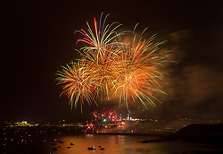 © Licensed to London News Pictures. 15/08/2019; Plymouth, Devon, UK. (Multiple exposure in camera) Day two of the British Fireworks Championships, with the third display by 1st Galaxy Fireworks. The British Fireworks Championships is one of the biggest firework displays in the country, held in Plymouth Sound each August when firework companies from across the UK compete for the best display. The British Fireworks Championships began in 1997 and Plymouth Sound harbour was chosen for the location as it provides a natural amphitheatre for large scale pyrotechnics that can be used safely away from the public but watched from many viewpoints around the Sound'. Photo credit: Simon Chapman/LNP.