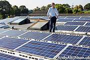 Andy O'Brien of Bristol Coop on top of the roof of Knowle West media centre, Bristol.