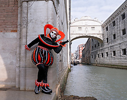 Masked woman in Carnival or Carnevale in Venice Italy