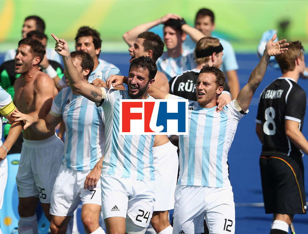 RIO DE JANEIRO, BRAZIL - AUGUST 16:  Argentina celebrate after their 5-2 victory during the Men's semi final hockey match between Argentina and Germany on Day 11 of the Rio 2016 Olympic Games held at the Olympic Hockey Centre on August 16, 2016 in Rio de Janeiro, Brazil.  (Photo by David Rogers/Getty Images)