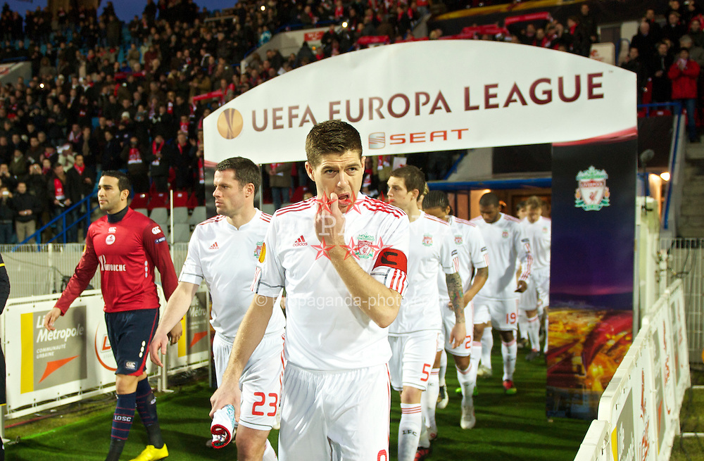 LILLE, FRANCE - Thursday, March 11, 2010: Liverpool's captain Steven Gerrard MBE leads his side out to face LOSC Lille Metropole during the UEFA Europa League Round of 16 1st Leg match at the Stadium Lille-Metropole. (Photo by David Rawcliffe/Propaganda)