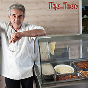 "Dionyssis Hastoukis 55, owner of  ""Pame Paketo""  take away restaurant that uses the TEM (local alternative currency).  One of the meals he offers daily is sold inTEMs and he offers the rest of the meals on TEMs after 16:30"