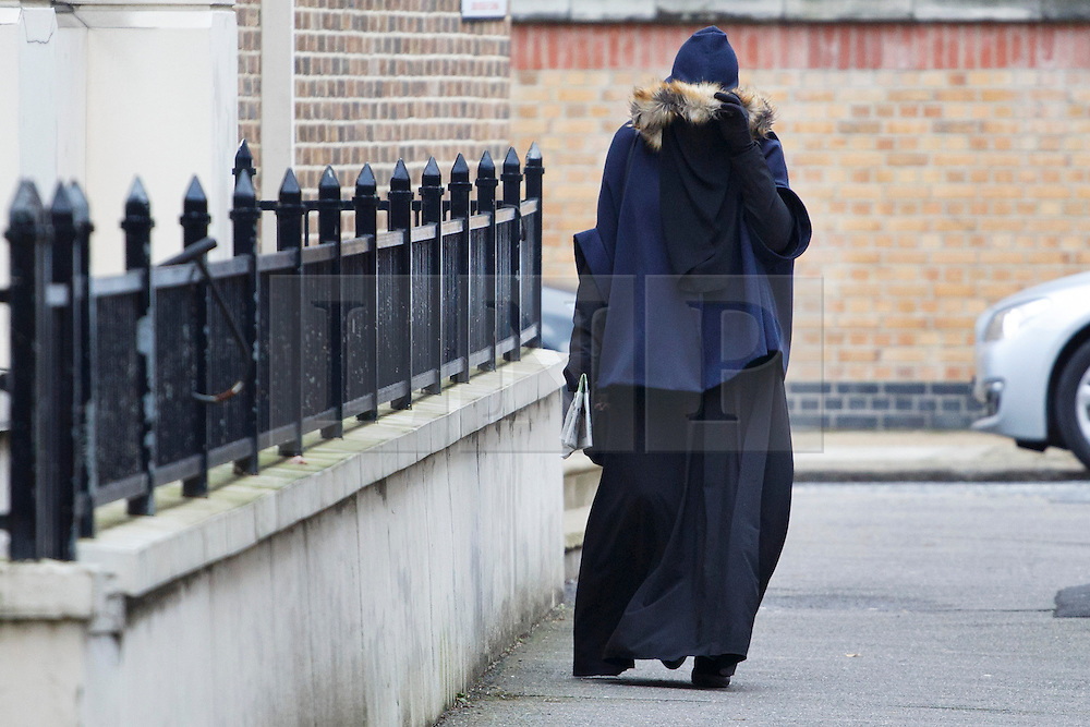 © licensed to London News Pictures. London, UK 24/01/2014. Rebekah Dawson arriving at Blackfriars Crown Court in London on Friday, 24 January, 2014. Rebekah Dawson is on trial for witness intimidation in relation to terrorism offences for disturbing videos praising the murder of Lee Rigby. Photo credit: Tolga Akmen/LNP
