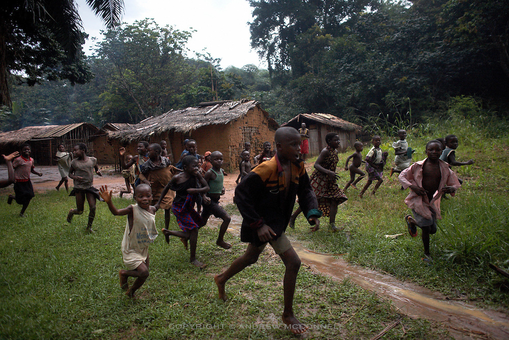 Villagers are roused by the sound of motorbikes and sight of white people as the NG Adventure team make their way through the outer reaches of the Yangambi Research Station, in Yangambi, DR Congo, on Sunday, Dec. 7, 2008. Villages are scattered throughout the 33 kilometers of Yangambi in clearings in the forest. The communities here live much as they have done for centuries, with no electricity and little access to the outside world.