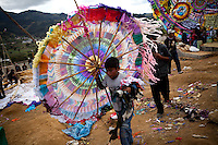 Guatemalans celebrate Dia de los Muertos with by flying colorful kites to scare off bad spirits so that the dead can enjoy offerings by the families, in Santiago Sacatepequez, Guatemala, on Tuesday, Nov. 1, 2011.