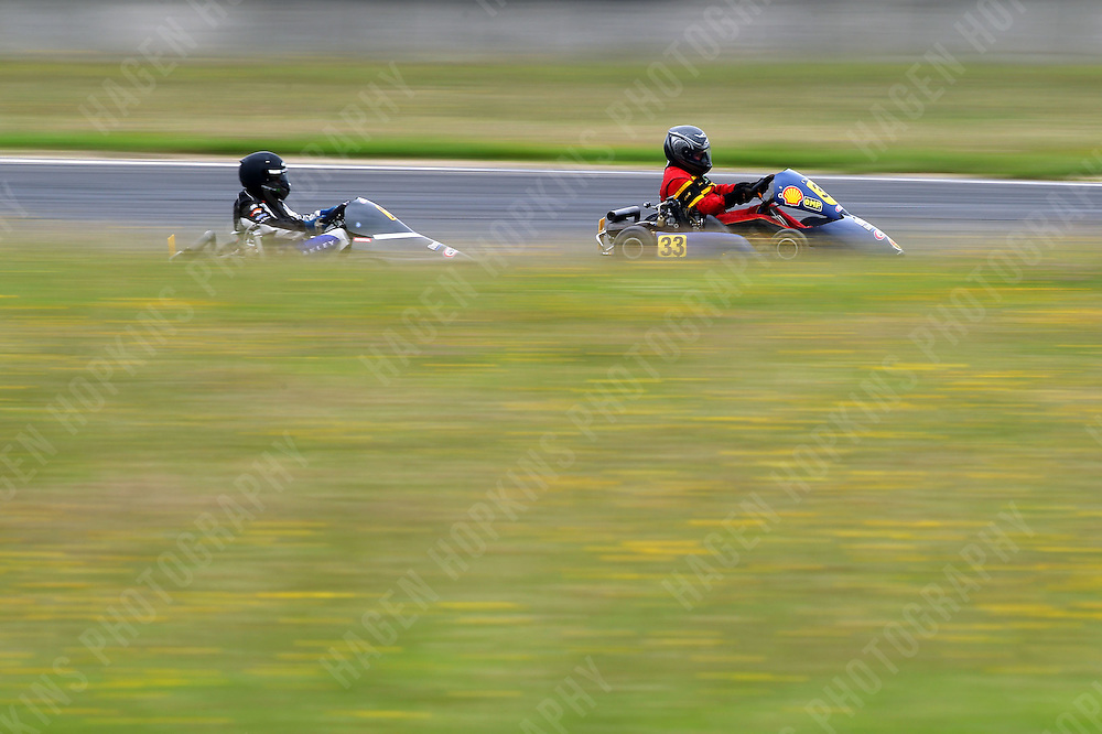 Sean Cuthbert, 33, and Karl Cameron, 2, race in the Rotax Heavy class during the 2012 Superkart National Champs and Grand Prix at Manfeild in Feilding, New Zealand on Saturday, 7 January 2011. Credit: Hagen Hopkins.