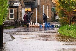 Flooding at the Junction of Whitley Lane and Church Street Ecclesfield locals prepare sandbags to protect their property<br /> <br />  Copyright Paul David Drabble<br />  07 November 2019<br />  www.pauldaviddrabble.co.uk