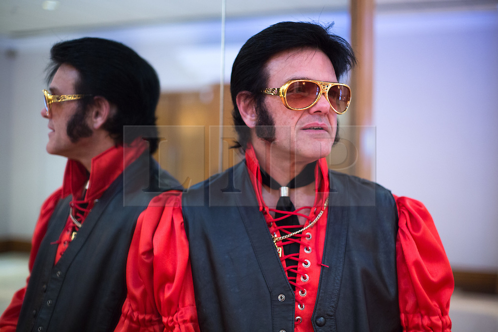 © Licensed to London News Pictures. 06/01/2017. Birmingham, UK. The European Elvis tribute artist contest taking place in Birmingham this weekend. The contest over three days has been taking place for twelve years and is timed to coincide with the anniversary of the birthday of Elvis. Over 80 acts will battle it out to be crowned European champion. Pictured, Johnnyelvis from Llantrisant in Wales. Photo credit: Dave Warren/LNP