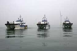 UK ENGLAND NORFOLK SHERINGHAM SHOAL 25SEP13 - Tidal Transit vessels Eden Rose, Tia Elizabeth and Ginny Louise pose for a group photo at the Sheringham Shoal wind farm in the North Sea off the Norfolk coast, England.<br /> <br /> <br /> <br /> jre/Photo by Jiri Rezac<br /> <br /> <br /> <br /> © Jiri Rezac 2013