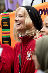 © Licensed to London News Pictures. 10/03/2018. London, UK. JOELY RICHARDSON takes part in the 'Million Women Rise' march through central London, campaigning against domestic violence against women. Organisers have asked participants to wear red for the demonstration. On Thursday (8 March) this week, International Women's Day was celebrated. Photo credit : Tom Nicholson/LNP