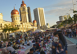 June 3, 2017 - Kuala Lumpur, Kuala Lumpur, Malaysia - People wait for their Iftar (breaking fast) meals at Merdeka Square during the holy month of Ramadan, (Credit Image: © Kepy via ZUMA Wire)