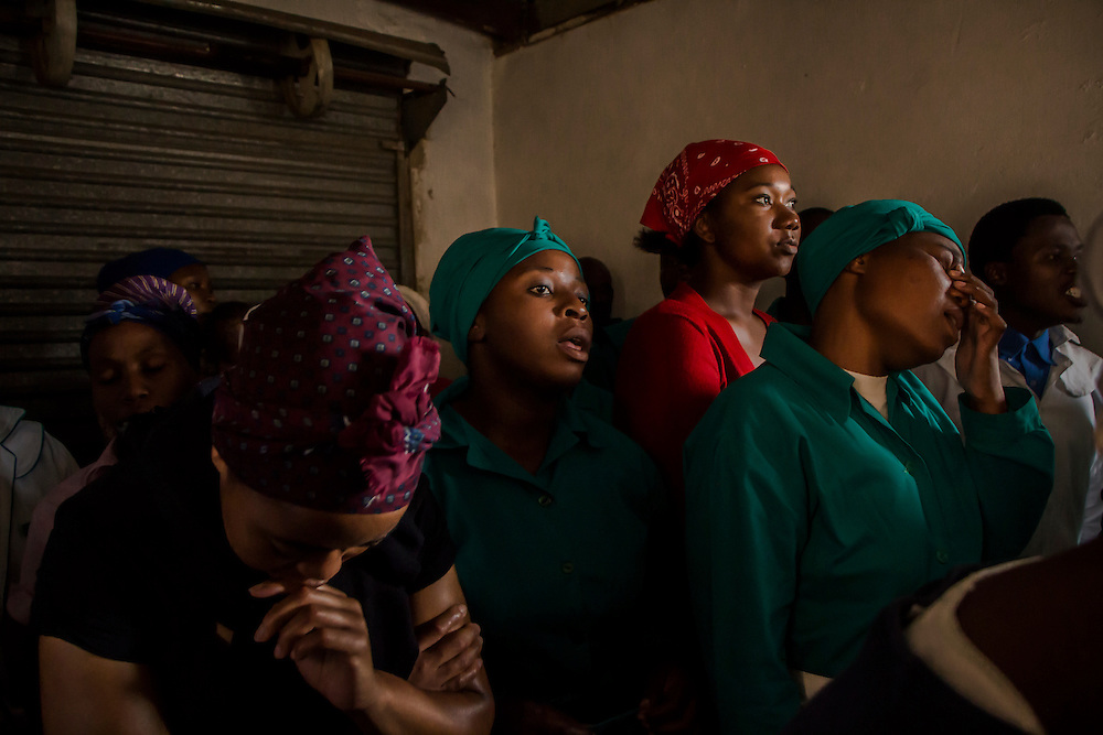 Members of the Zionist Mission Church gathered  in a tiny room of less than 10 square meters to attend a service for Nelson Mandela in Orlando West, Soweto, on Sunday Dec.8 2013.