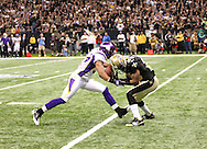 NEW ORLEANS - JANUARY 24: Reggie Bush #25 of the New Orleans Saints fumbles a punt as he is hit by Eric Frampton #37 of the Minnesota Vikings at the NFC Championship Game at the Louisiana Superdome on January 24, 2010 in New Orleans, Louisiana. The Saints won 31-28 in overtime to advance to the Super Bowl for the first time. Photo by Tom Hauck.