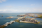 Nederland, Noord-Holland, Amsterdam, 16-04-2008; IJburg met de Enneus Heermabrug (de dubbele boogbrug) die toegang tot de nieuwbouwwijk, met als eerste eiland rechts het Steigereiland (op dit eiland mogen op de  zogenaamde vrije kavels eigen woningen - naar eigen ontwerp - gebouwd ; in het verschiet het centrum van IJburg met het Haveneiland;IJburg with Enneus Heerma Bridge (the double arch bridge) with access to the new district, with the first island Steigereiland the right; on this island are the so-called free plots where ownes can build to their own design; ..  .luchtfoto (toeslag); aerial photo (additional fee required); .foto Siebe Swart / photo Siebe Swart