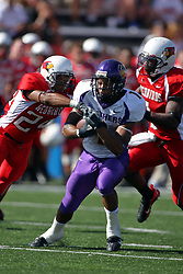 29 September 2007:  Corey Lewis runs and cuts his way up the field, but gets between the arms of Kelvyn Hemphill. In action between the Northern Iowa Panthers and the Illinois State Redbirds, the Panthers chewed up the Redbirds by a score of 23 - 13. Game action commenced at Hancock Stadium on the campus of Illinois State University in Normal Illinois..