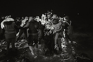 Migrants rush off a boat as rescue workers discover dead bodies on the boat. Lesbos, March 20, 2016.