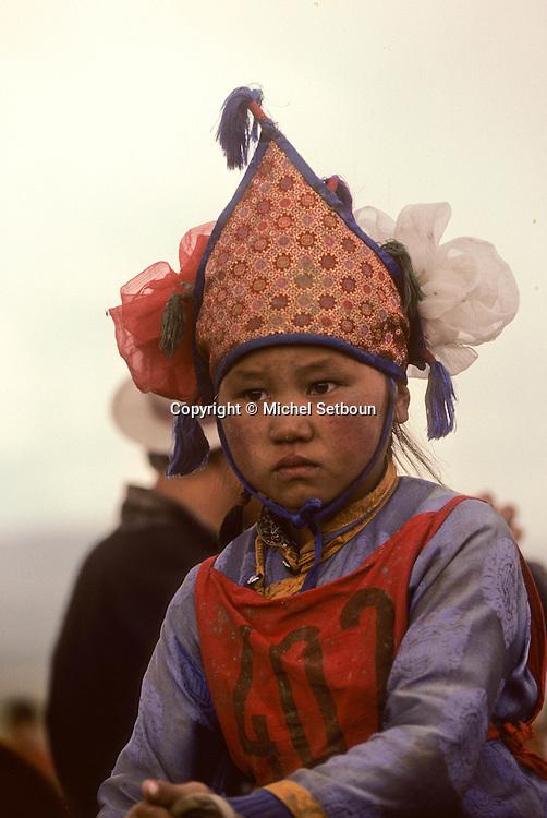 Mongolia. Kidís horse race; naadam of Oulan Bator   /  course des chevaux des enfants Grand Naadam de Oulan Bator .Mongolie.   57      P0003222