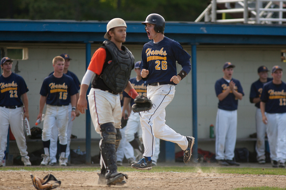 Braintree, MA 06/11/2012.Xaverian's Alex Person celebrates as he crosses home plate in the 7th inning of Monday's MIAA Division 1 South Finals in Braintree..Wicked Local Photo by Alex Jones