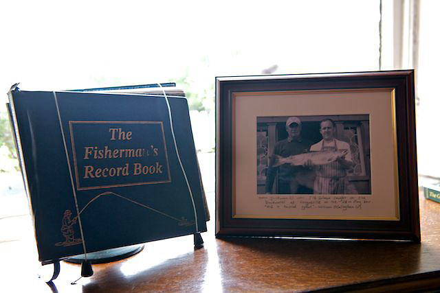 Fishermans record book and picture at Longueville house.