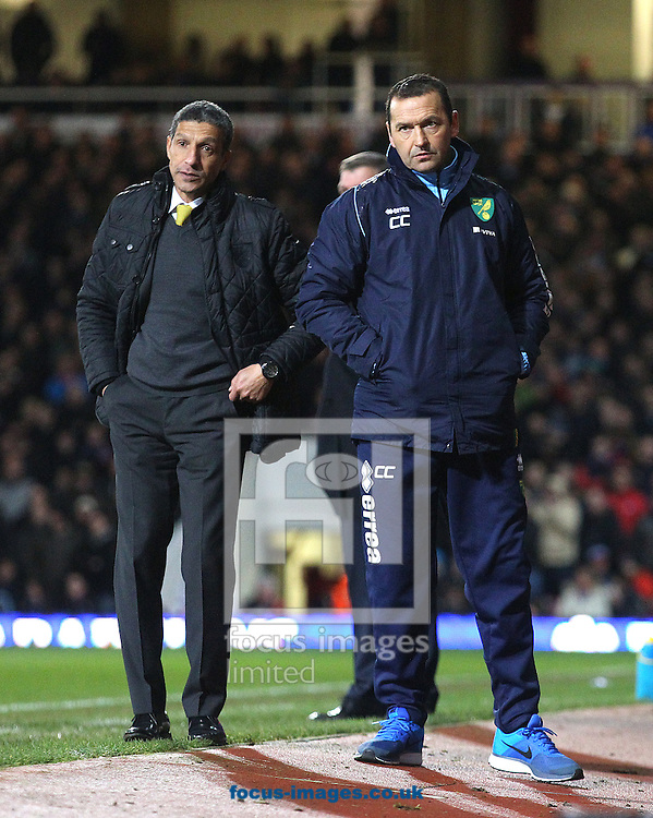 Picture by Paul Chesterton/Focus Images Ltd +44 7904 640267<br /> 11/02/2014<br /> Norwich Manager Chris Hughton and Norwich Assistant Manager Colin Calderwood look dejected during the Barclays Premier League match at the Boleyn Ground, London